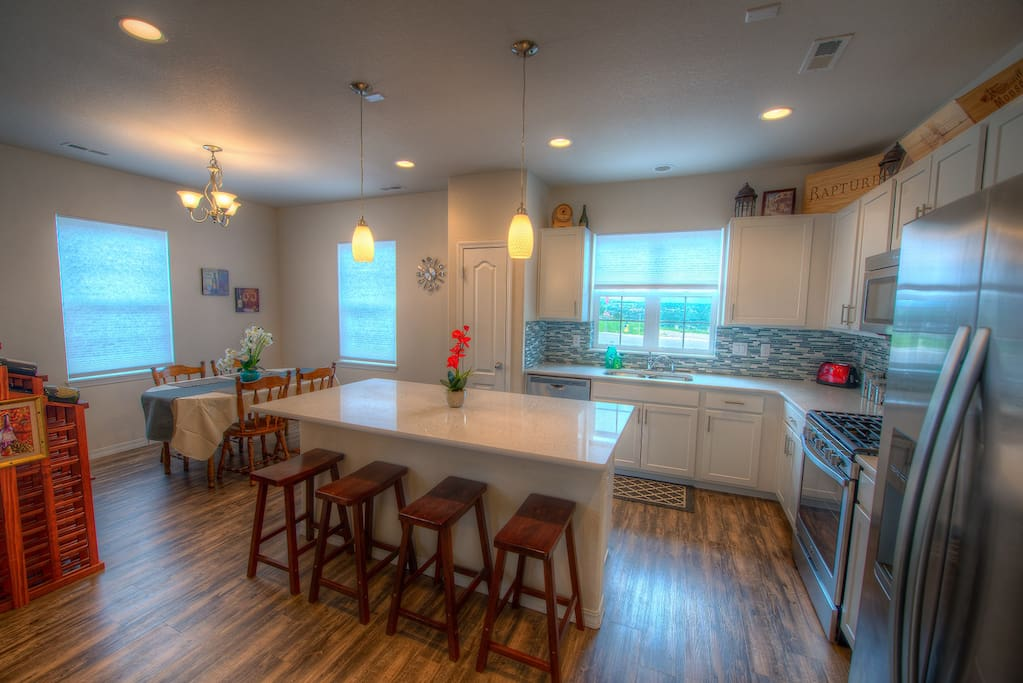You'll love cooking in this gourmet kitchen with quartz counter tops and brand new stainless steel appliances!