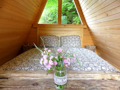 A lovely wooden cabin for 2 surrounded by greenery