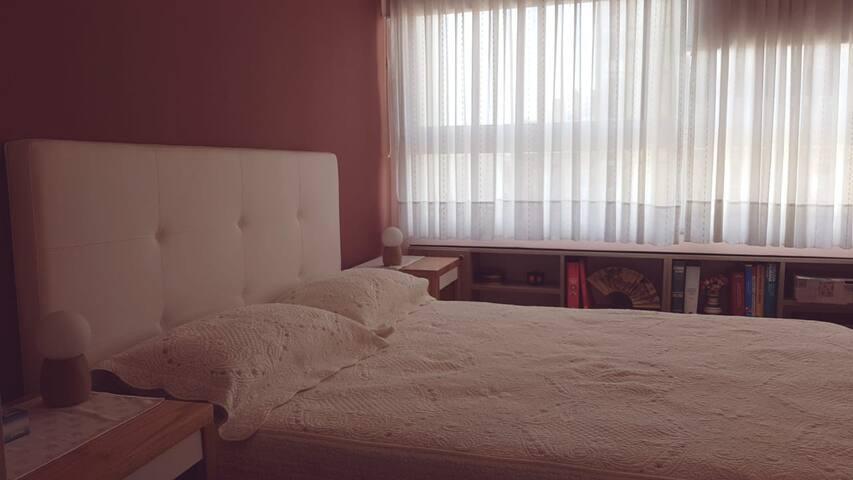 Dormitorio en suit con vestidor