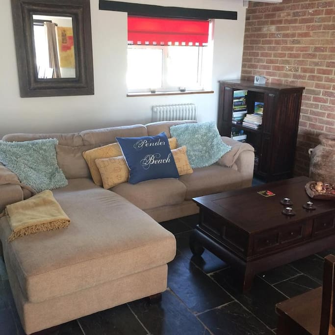 Living area with sofa & TV  (Sky TV & Netflix available).