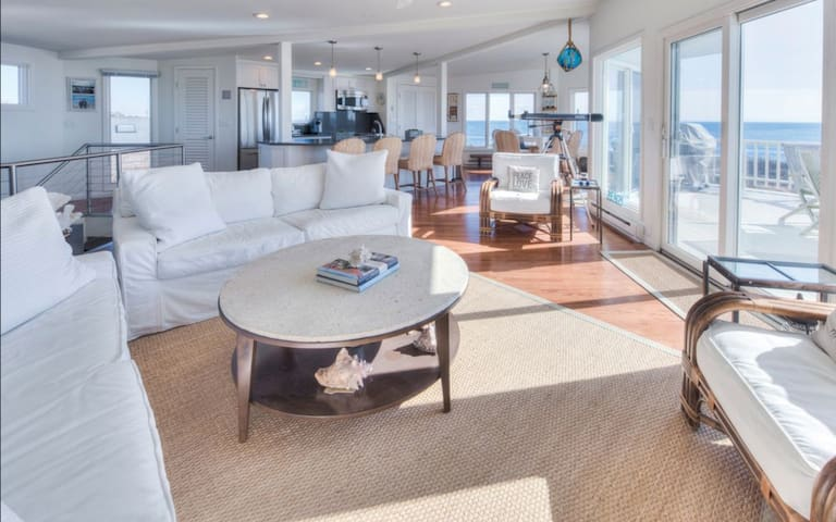 Living room with views of ocean