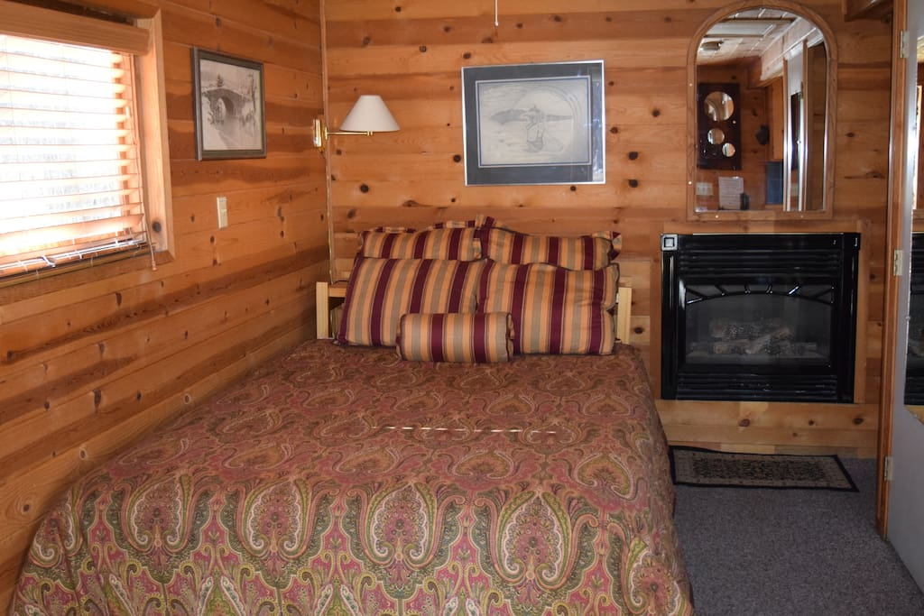 Queen size bed with gas fireplace