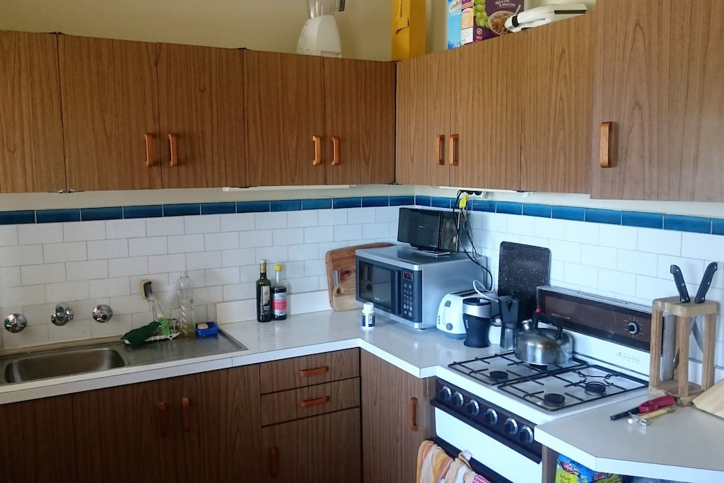 Medium size kitchen with gas oven, microwave, fridge and all cooking utensils.