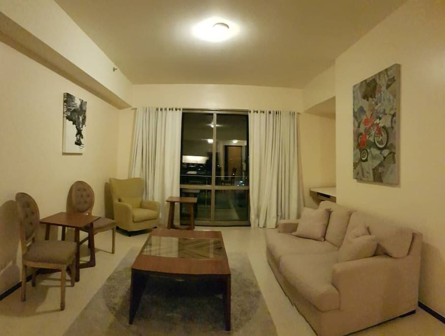 Living room with dining walking distance to greenhills mall