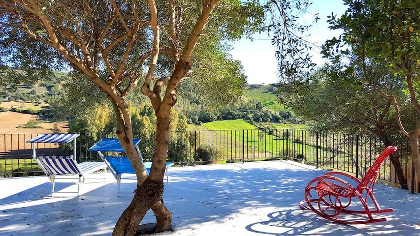 Terrace (common area) at garden level with table, relax area, wi-fi, calcio balilla, washing machine
