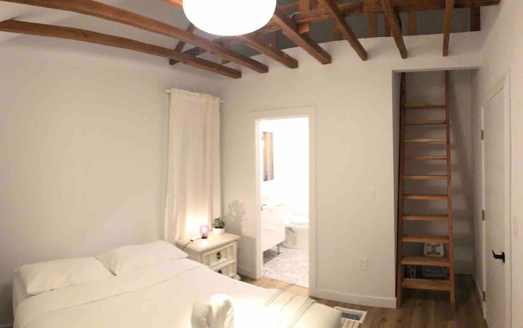 Bedroom and access to the loft sleeping area