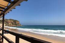 View onto the beach from Burgau beach bar, a great spot at 5 minutes walk from the apartment in the quaint and traditional fishing village.