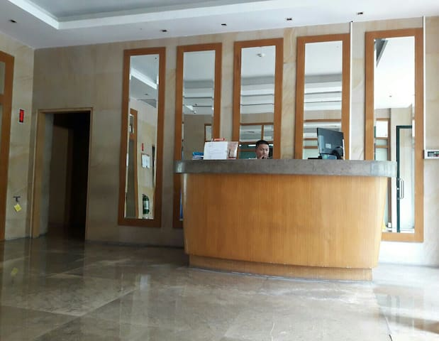 Courteous lobby guard at the reception area