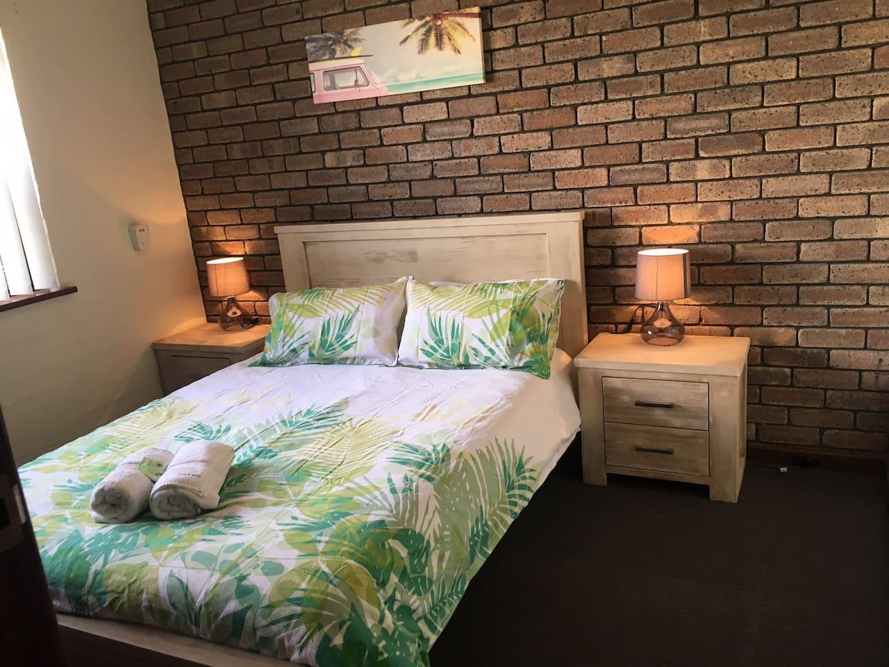 Main bedroom queen bed.