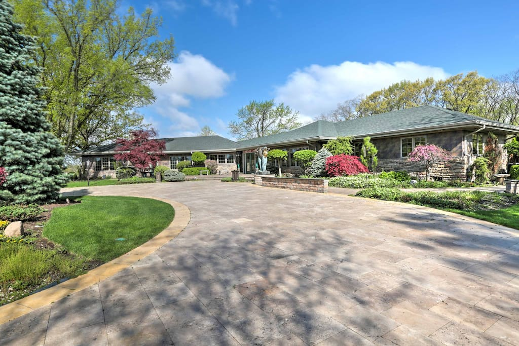 The home is situated on 5 well-groomed acres with a massive waterfall fountain.