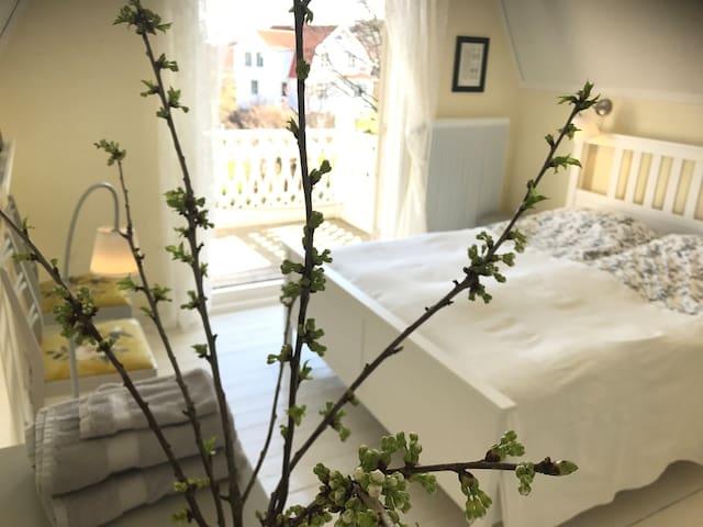The 'Balcony Room' has a double bed and can be fitted with an extra floor mattress or a toddler bed.