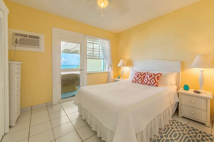 Ocean side bedroom with access to your private veranda and the beach just beyond.