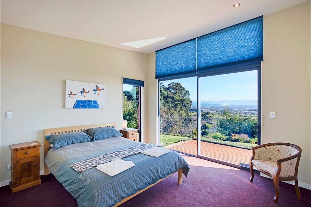 Bedroom 1 with view to mountains and ocean