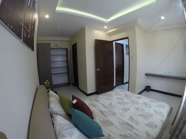 2nd bedroom with Queen size bed, closet, own bathroom with hot shower and washing machine.
