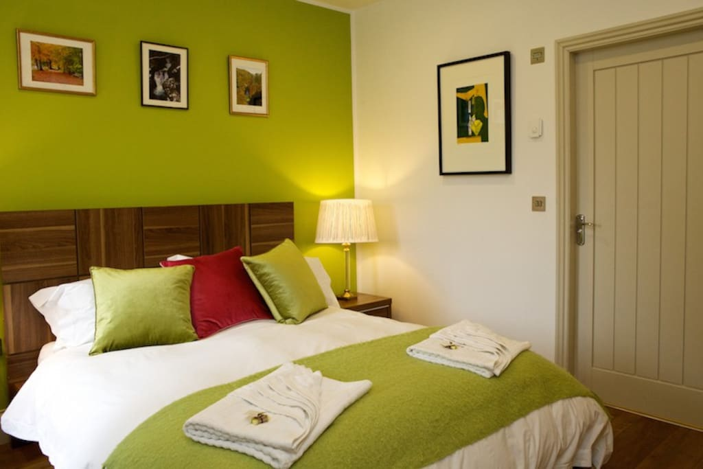 Modern, Bright, colourful and comfortable master bedroom with en-suite