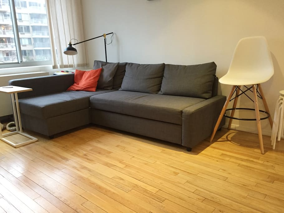 Spacious couch in living room to make yourself at home