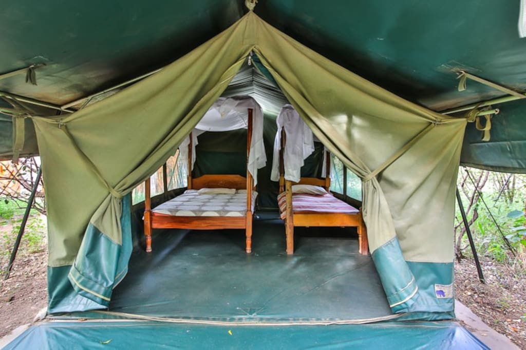 Tent variation #2 with two twin beds // cozy tent with beautiful view to Talek river