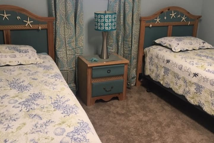 Cute Coastal theme bedroom upstairs  can be pushed together for another king bed option