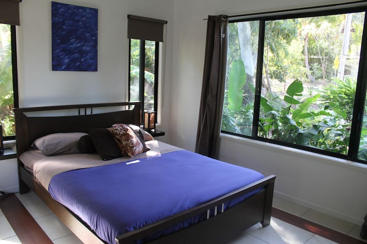 Guest Bedroom looks onto the tropical garden and nearby hills