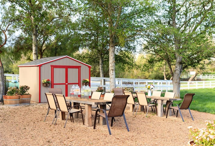 Community Area with Hand Built Wooden Picnic Tables