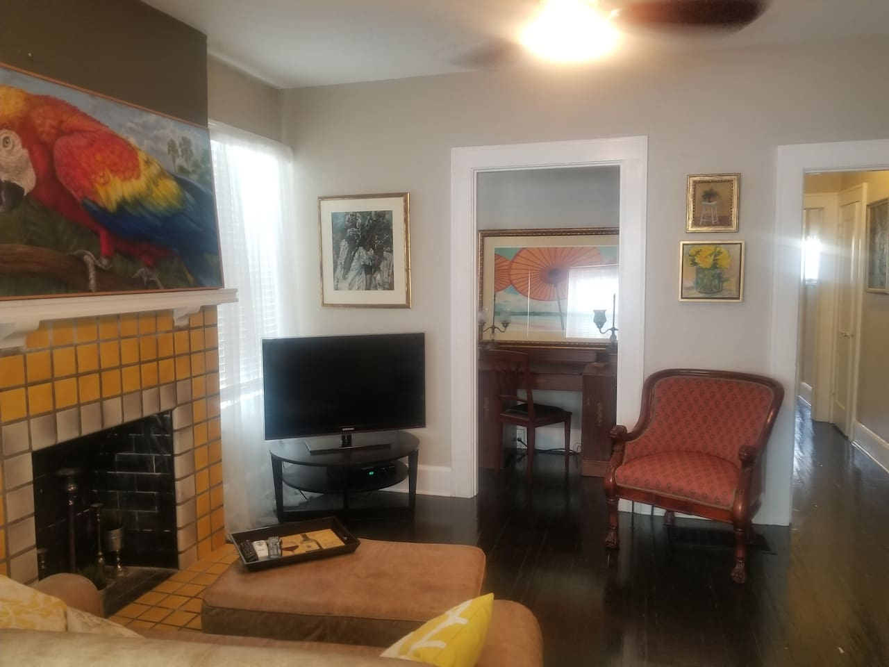 Living room with original 1920's tile fireplace, smart tv, adjoining office alcove