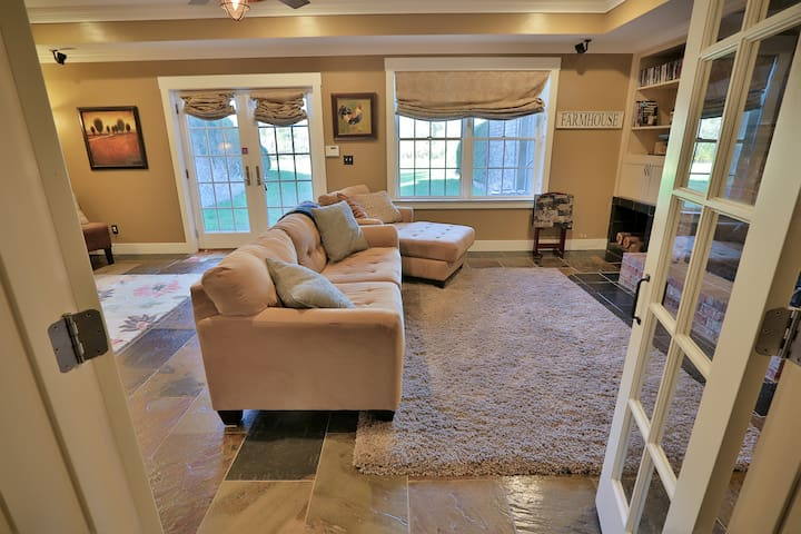 The large family room with private walkout entrance to the huge back yard.