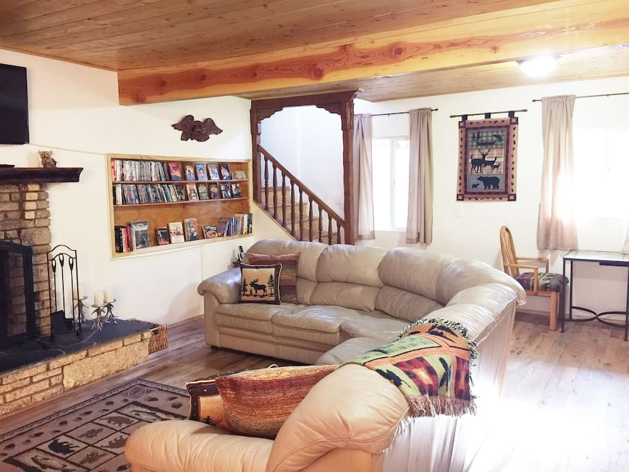 Open Living Room with Large Sectional Sofa & DVD Library