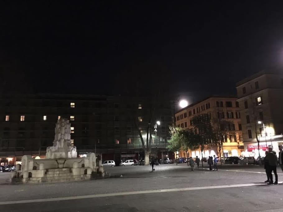 Testaccio Square in the evening and the moon who is coming