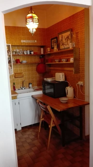 Kitchen with oven and 4 burner stove