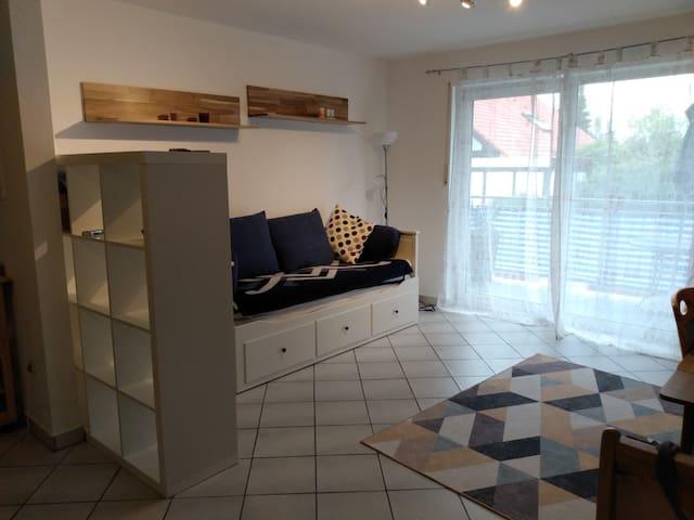 Wohnbereich mit Balkon und Essecke (nicht im Bild) , (living area with balcony and dining table, not pictured)