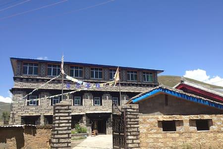 It's a Tibetan style HOUSE - Garze