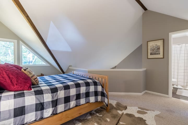 Master Bedroom Loft features an on-suite full bath and overlooks the bottom floor Den and Dinning area