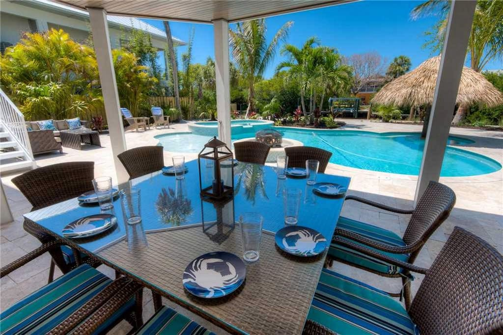 Covered patio seating by pool