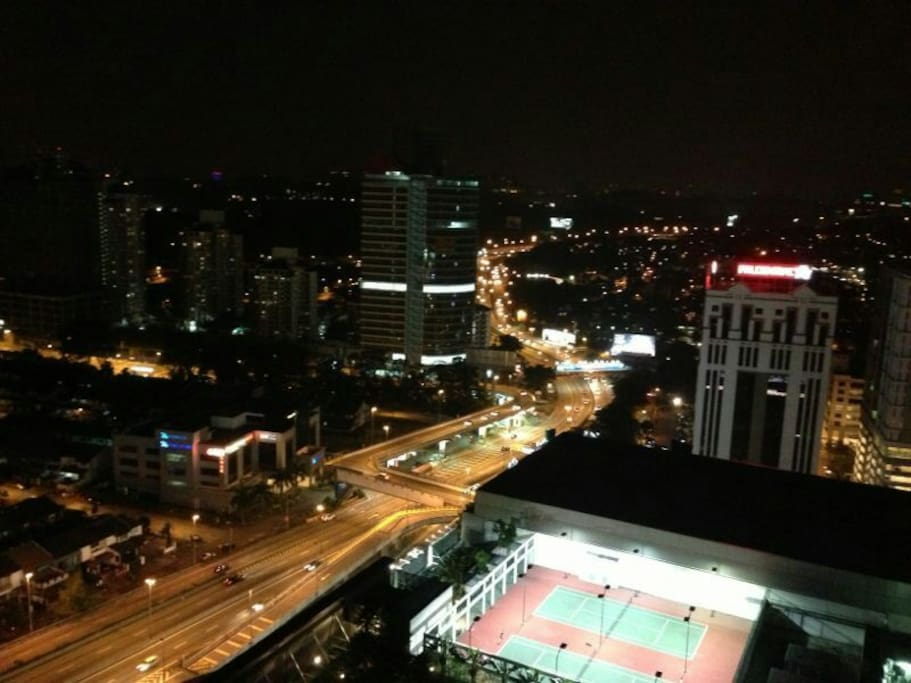 Night view to tennis courts and highway lights