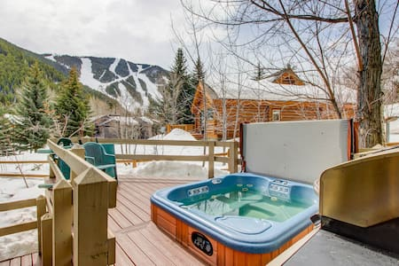 Dog-friendly lodge w/ private hot tub, mountain views, and centralized location!