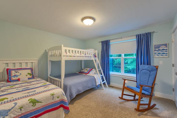 upstairs bedroom 1 with crib, twin over full bunk, and twin bed (3 beds total, plus crib)