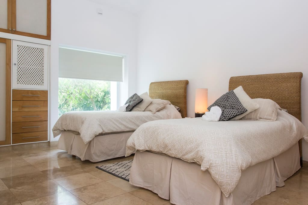 """Second room. 2 single beds. Spacious private bathroom. AC... let's get a good rest. Noriko: """"The location was optimal in such a private and peaceful setting. You will wake up with birds chirping and butterfly flying outside of the window"""""""