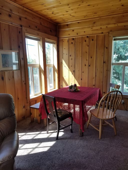 A view of the sunny dining area from the living room area