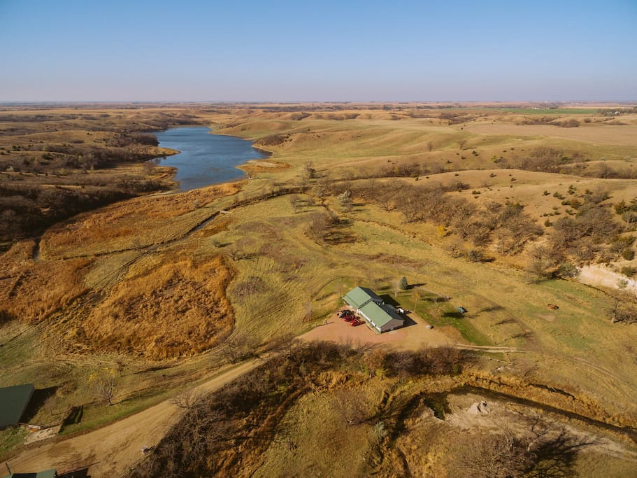 Arial photo of the lodge and beautiful land surrounding it.