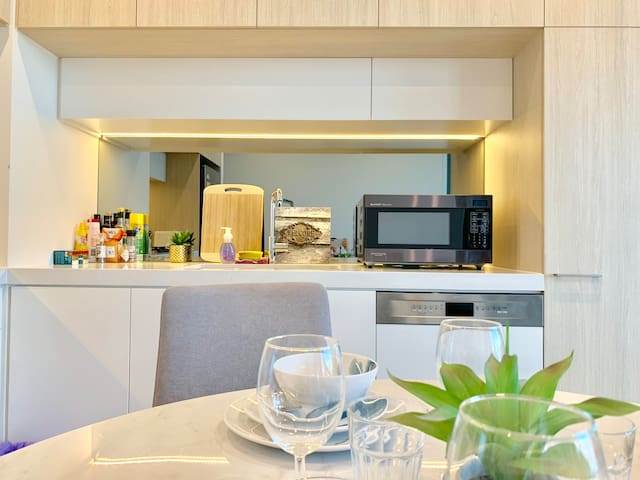 Fully equipped kitchen will all pots and cutlery, microwave and oven. Enjoy a nice meal in this beautiful stunning City view high level apartment!