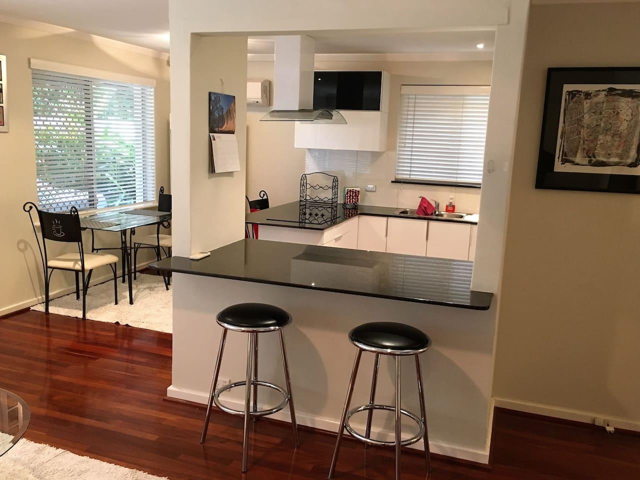 Jarrah polished floors,granite bench tops