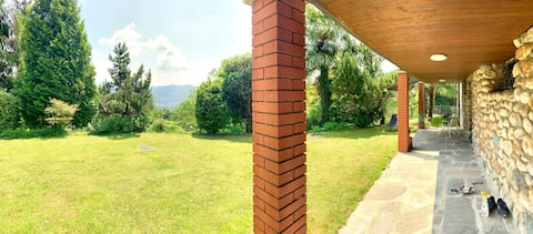 Casa con giardino e vista sul Lago Lugano-Caslano