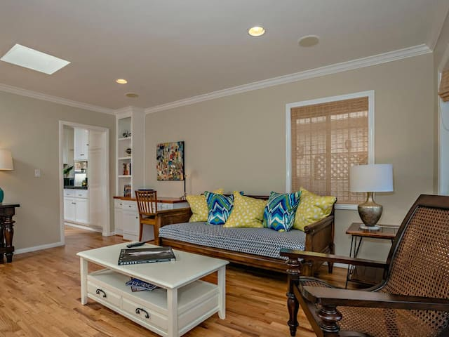 Front room has a built in desk, comfortable seating and large TV