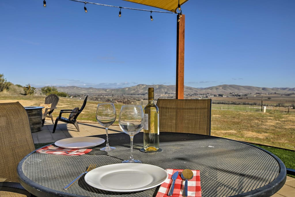 Enjoy a glass of wine while looking out over the vineyards and mountains.