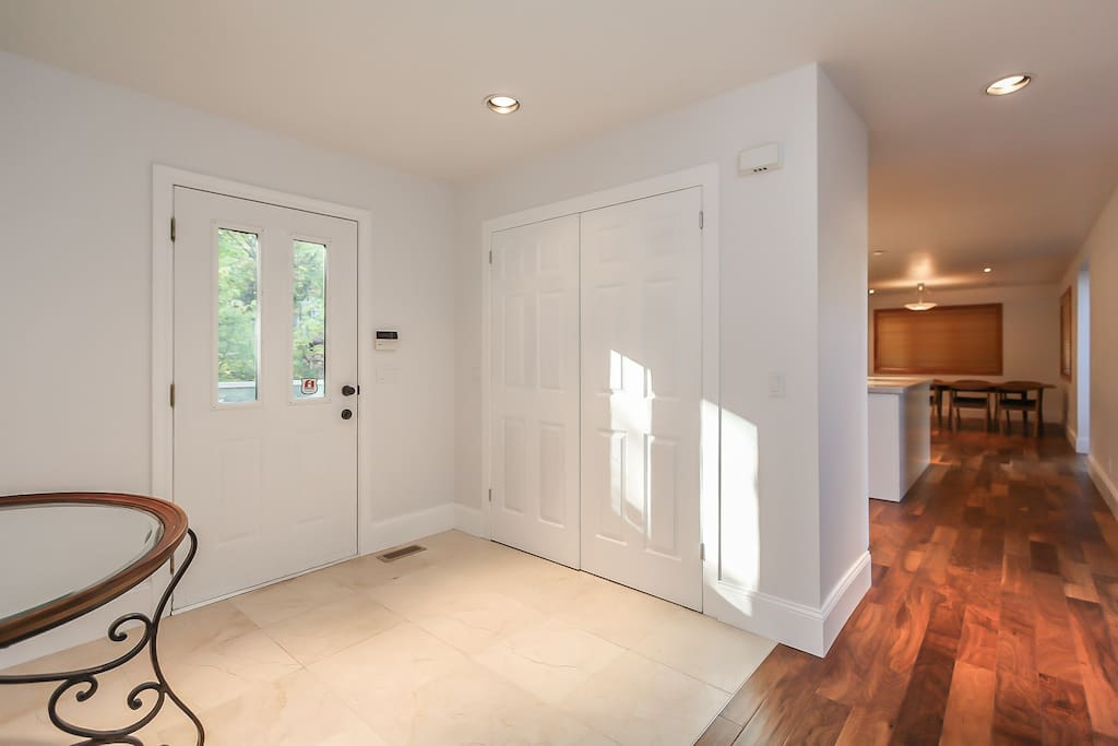 The inviting foyer has brand new marble flooring with plenty of closet space.