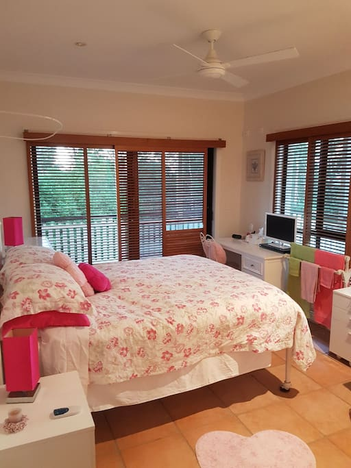 double bed with leafy distant ocean views