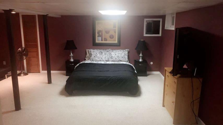 Private Bedroom with futon, half bath, TV, fridge