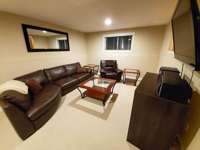 Family Room full equipped with comfy couches and an entertainment system!