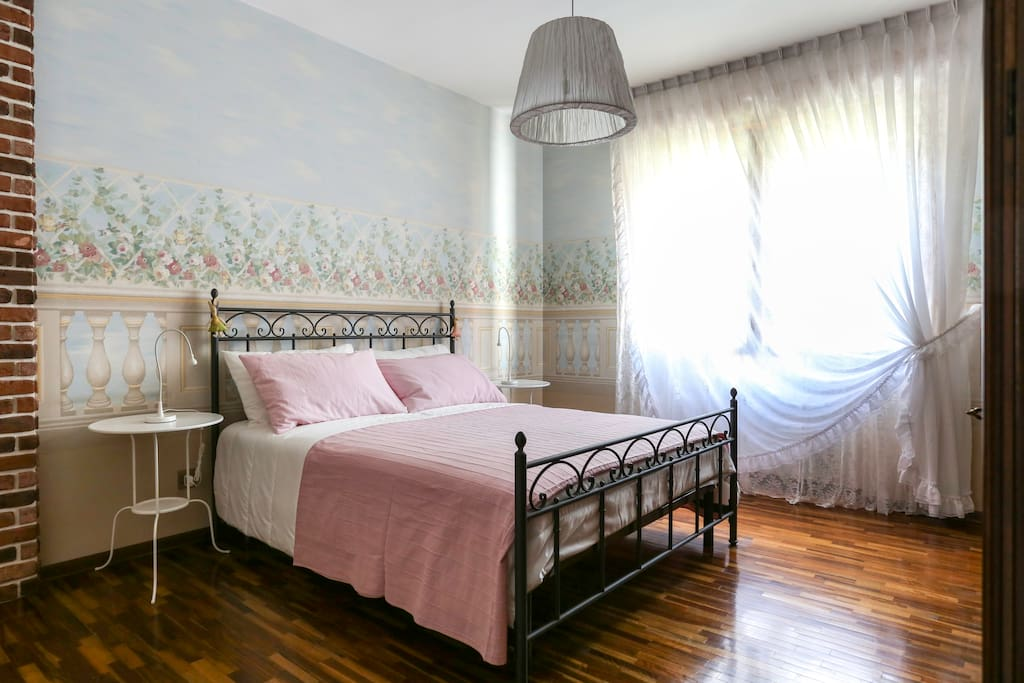 Main bedroom, wallpaper with floral patterns & relaxing colors