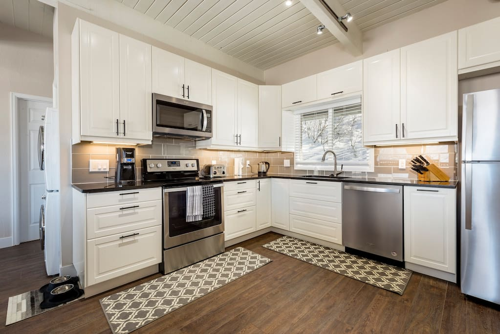 Beautiful kitchen space with all the amenities you need to enjoy your vacation. Stainless appliances, quartz counters and well stocked staple supplies.